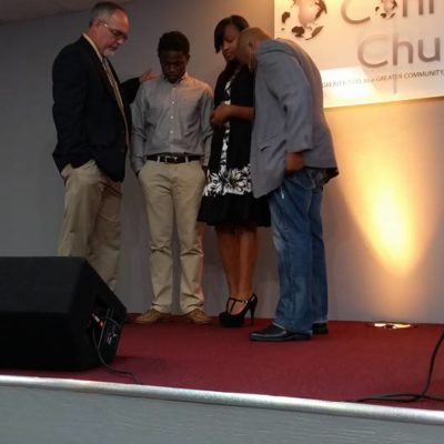 Pastor Tez and Ben praying over youth going to college